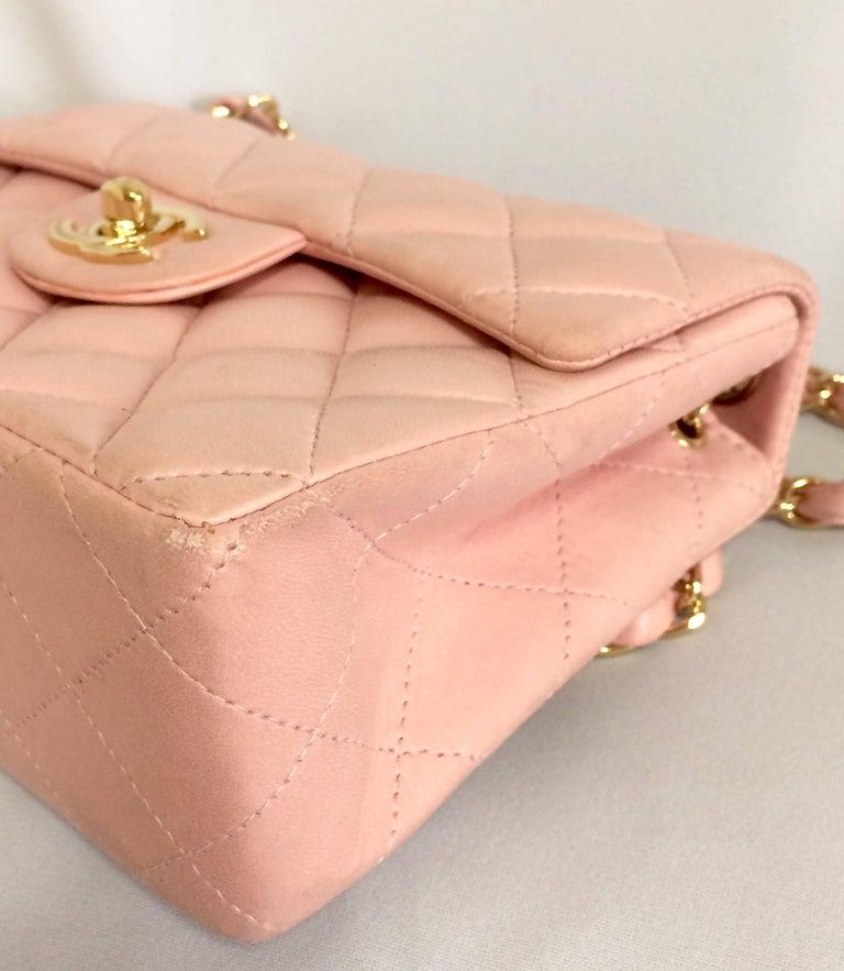 Women's Vintage CHANEL pink lamb leather classic flap chain mini 2.55 shoulder bag. For Sale