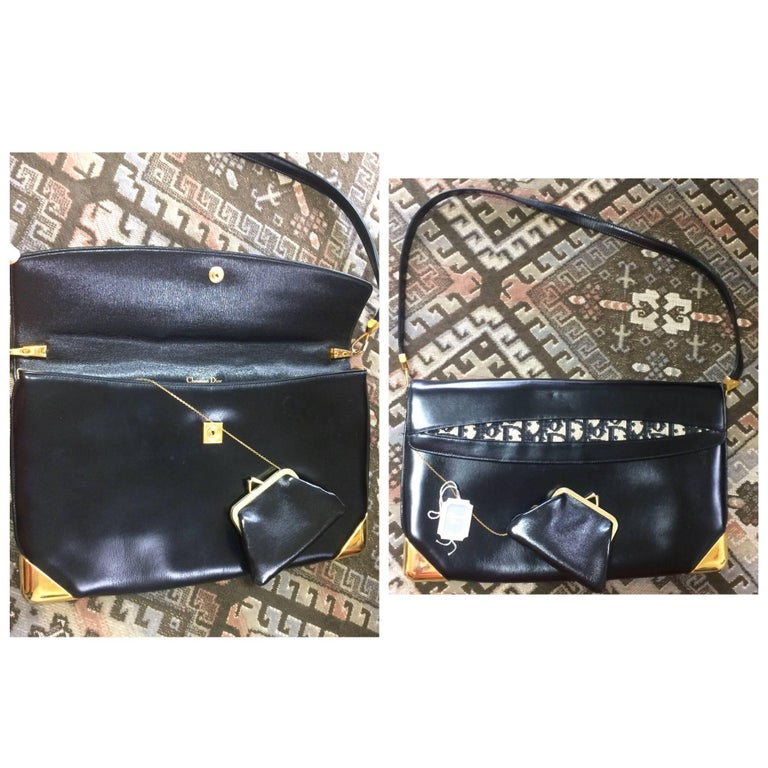 1980s. Vintage Christian Dior black leather large clutch purse, shoulder bag with navy trotter jacquard and golden frames. Comes with coin case.  This is a  Christian Dior genuine black calfskin classic large clutch shoulder bag, featuring golden