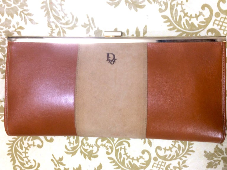 1970's Christian Dior vintage beige suede and tanned brown leather clutch purse with kiss lock closure. Can be a wallet coin wallet or cosmetic pouch.   Looking classic and elegant!   This is a Christian Dior vintage leather clutch purse with golden