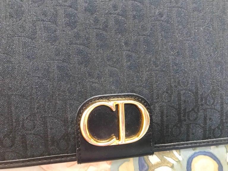 Vintage Christian Dior black logo jacquard shoulder bag, clutch with gold motif. For Sale 1