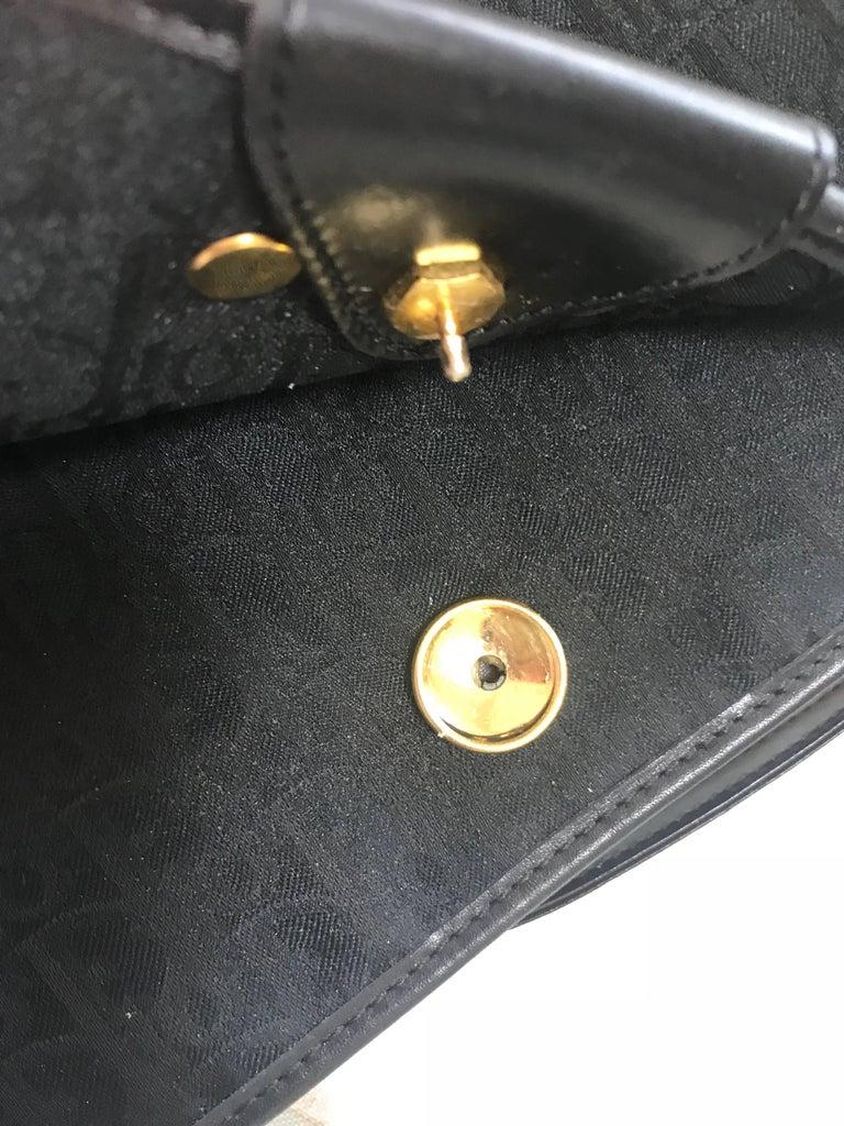 Vintage Christian Dior black logo jacquard shoulder bag, clutch with gold motif. For Sale 3