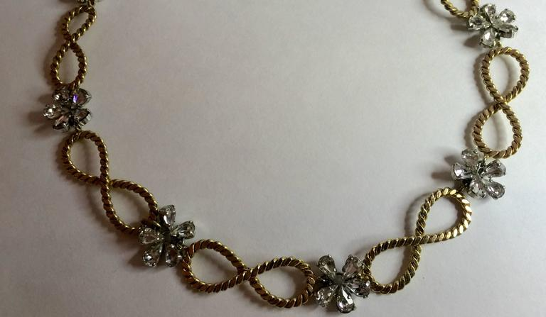 This 1950's CHRISTIAN DIOR Braided Looped and Floral Rhinestone Necklace is a lovely example of late 50's style , restraint and elegance in fashion. An era in the USA marked by Mamie Eisenhower's style and choices, this subtle, fine and small scale