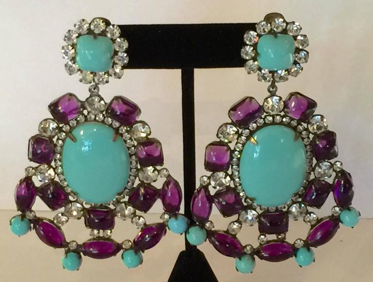 Gloriously opulent, these 1960s KJL Massive Faux Turquoise Amethyst Drop Clip On Earrings are statement designs by storied designer Kenneth Jay Lane, these are his iconic mogul design series HUGE drop earrings from the MOD and exotic 1960s. A