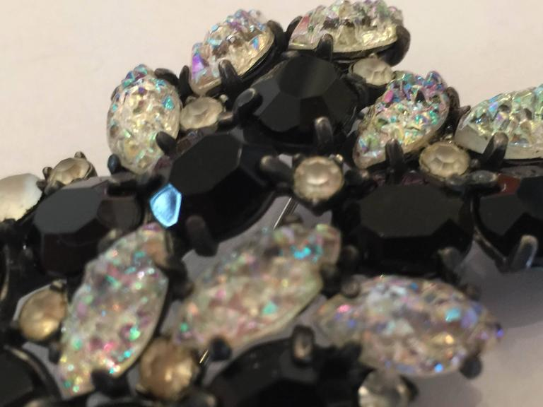 An exotic1950s SCHIAPARELLI Lava Rock Borealis and Black Brooch Pin, the exotic clear borealis lava rock stones paired with faceted jet black crystals is dramatic and impactful, indeed. A medium size pin approximately 2.25