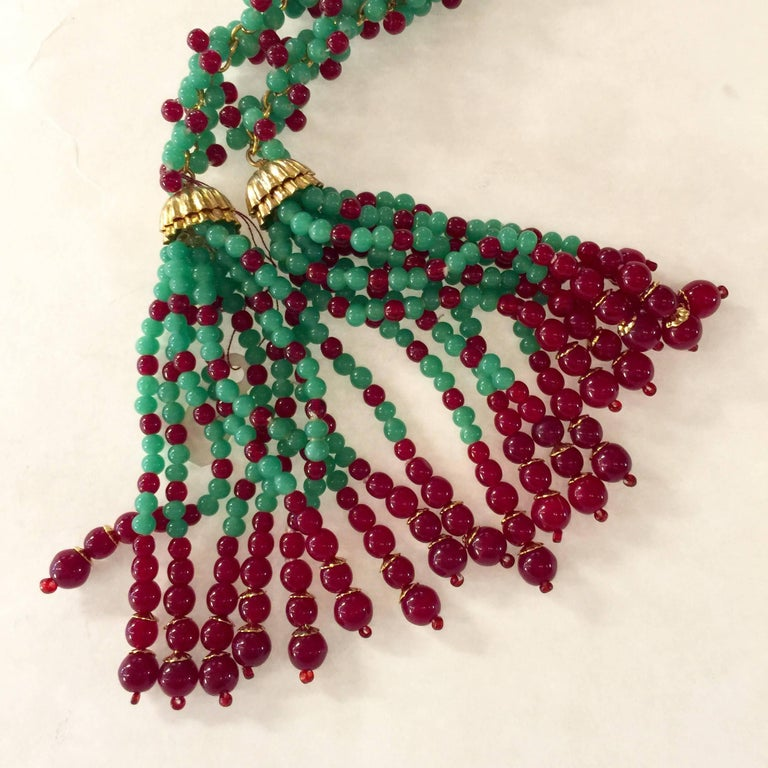 This late 1960's early 1970's  William DeLillo Faux Emerald and Ruby Multi Functional Lariat Tasseled Necklace is an amazingly versatile piece of Jewelry. Its wearability is amazingly diverse whether simply draped around the neck, tied once for a
