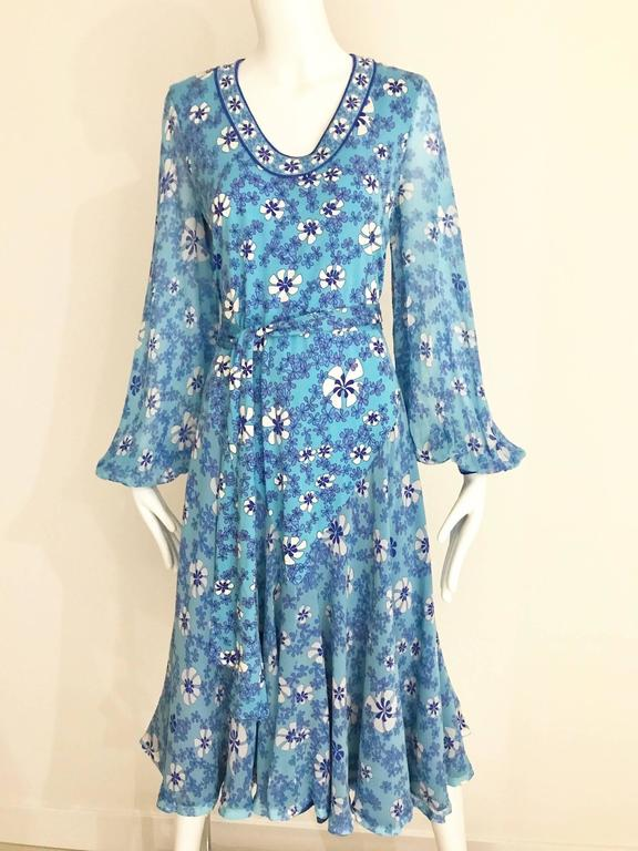 """Vintage Averado Bessi  blue and white mod floral print silk jersey summer dress with billowy sleeves. Dress comes with sash. sleeves is made of silk chiffon. Dress is lined in silk. Bust: 38""""  Waist: 34"""" / Hip: undefined/  Dress length: 43"""" Fit"""