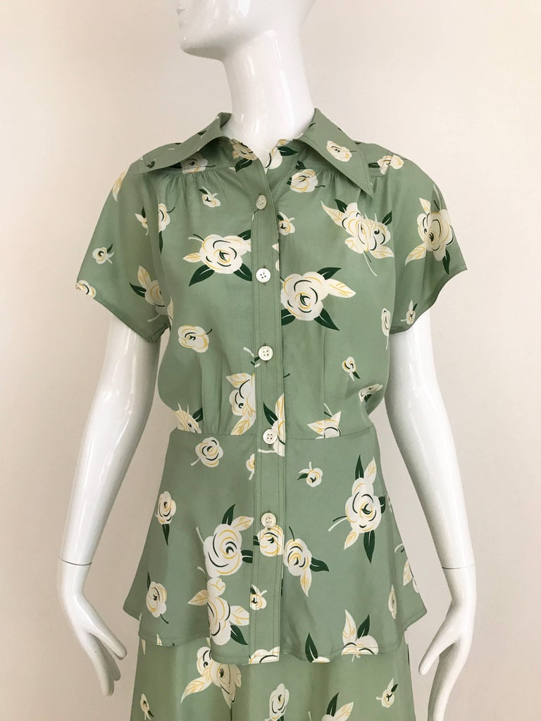 1970s Guy Laroche light green floral print blouse and skirt set. Blouse has slightly peplum style.  Size: small 4 Blouse measurement: Bust 36 inches/ Blouse Waist 30 inches /Length: 25 inch Skirt waist: 26 inches, Hip 38 inches/ Skirt length: 30.5