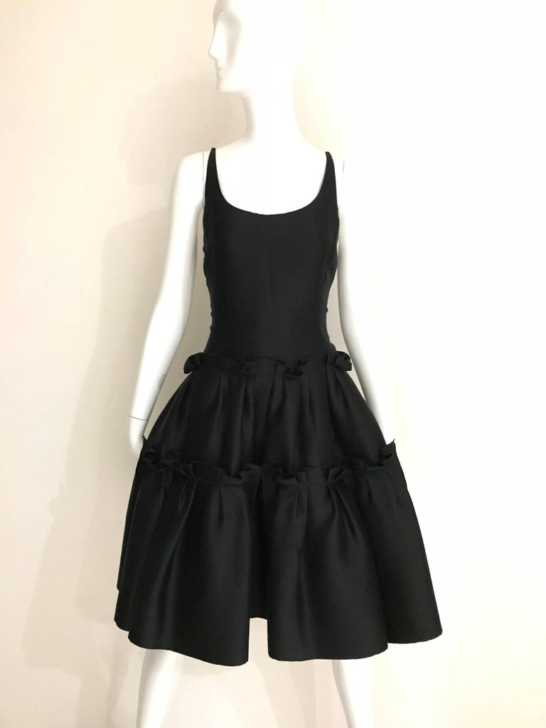 Elegant Oscar De La Renta Black Silk Shantung Cocktail Dress with thin spaghetti strap with tulle flair skirt . Dress zipped at the back.  Size: 4 / Small  **** This Garment has been professionally Dry Cleaned and Ready to wear.