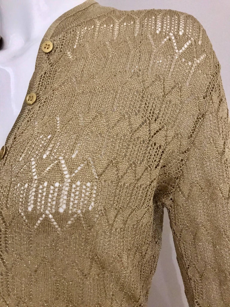Gold metallic knit Christian Dior by John Galliano Cardigan and fitted long skirt set. Fit Size 4