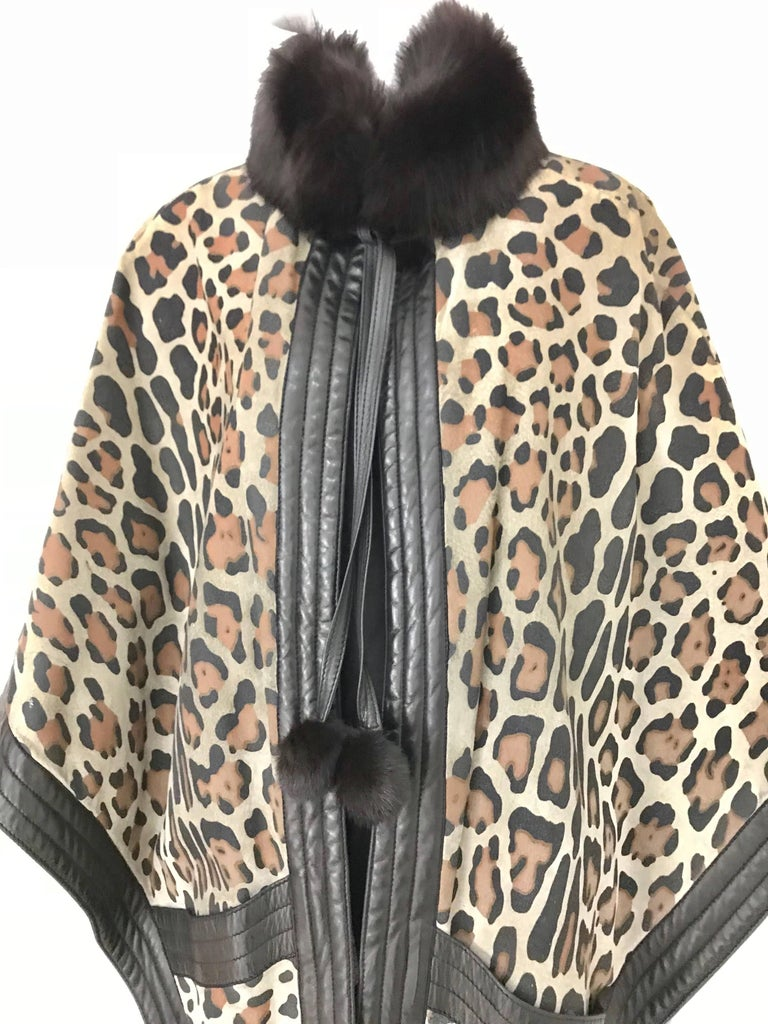 Incredible Vintage Christian Dior Suede Leopard Print Cape lined in wool with fox fur collar and leather tassel. Cape has 2 front pockets and 2 inner pockets.   Fit all Size.  Small to LARGE  /Mannequin is size 2 ( XS)