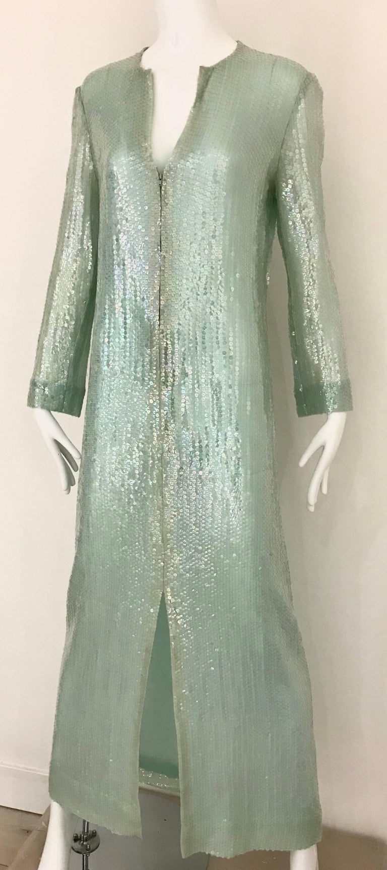 Vintage 70s Halston light green iridescent sequin caftan dress with zipper and belt. Dress has zipper in the middle and thin belt. Size 6/ Medium Bust: 38 inches/ Waist: 34 inches/ Hip: 37 inches Dress Length: 57 inches Arm length from shoulder- 22