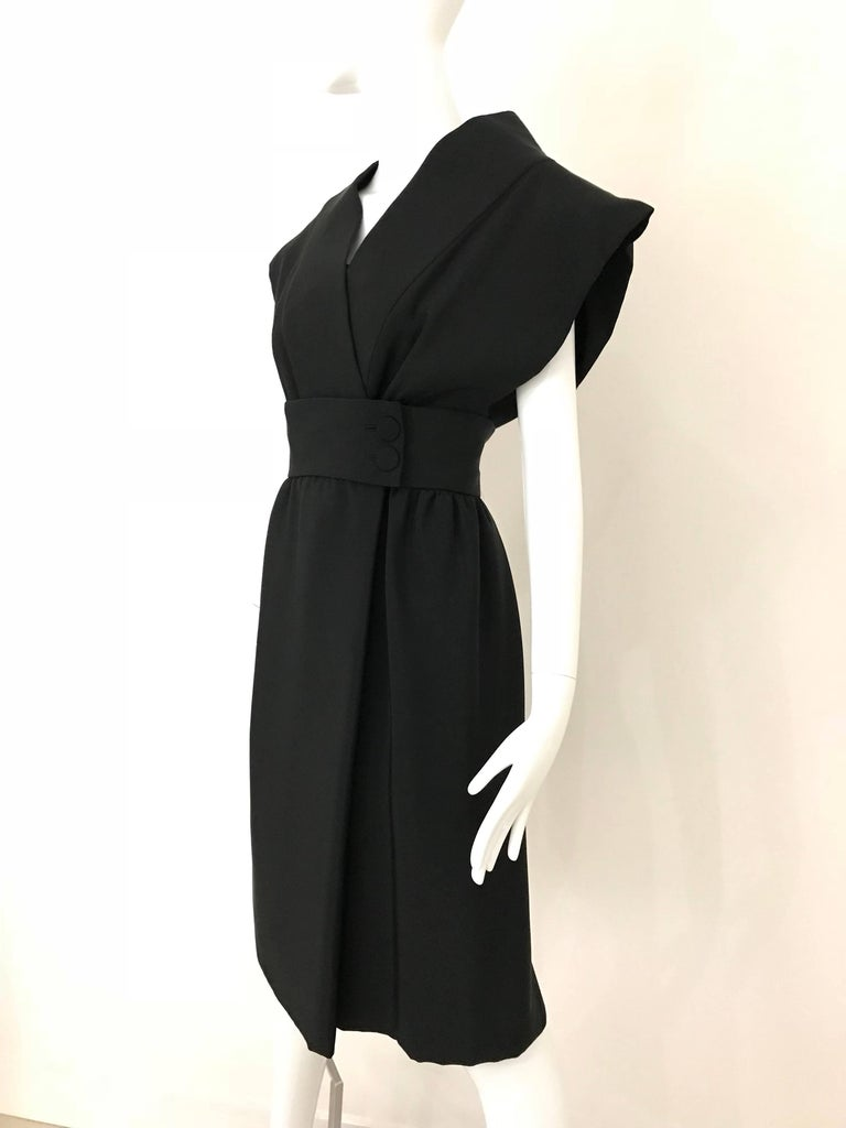 Important Norman Norell Couture black Silk Obi Cocktail Dress.  The museum of FIT will exhibit Norman Norell clothing in February.   Fit size 4/ Small Bust: 34-36  inches Waist: 26 inches