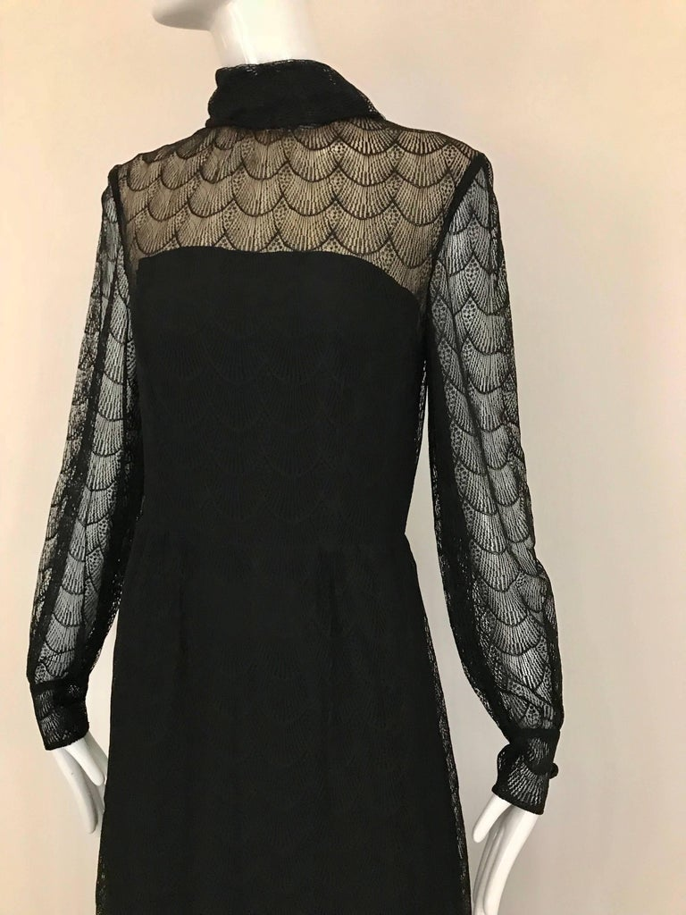 Beautiful 70s GIVENCHY black lace maxi dress cocktail party dress. Dress is lined in silk.  Bust 36' waist 28' hips 40' length 56'. Made in France.