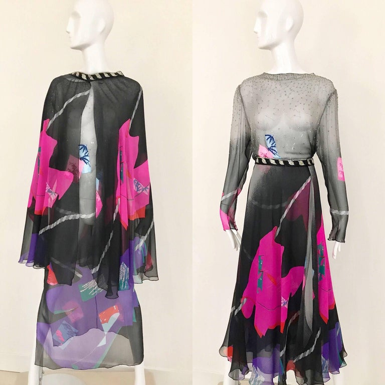 This 80's Hanae Mori ensemble is very elegant with it's black silk chiffon with pink abstract print work. It is very versatile, as the skirt can be worn as a cape which changes the feel of the 2 piece ensemble. The waist of the skirt has a special