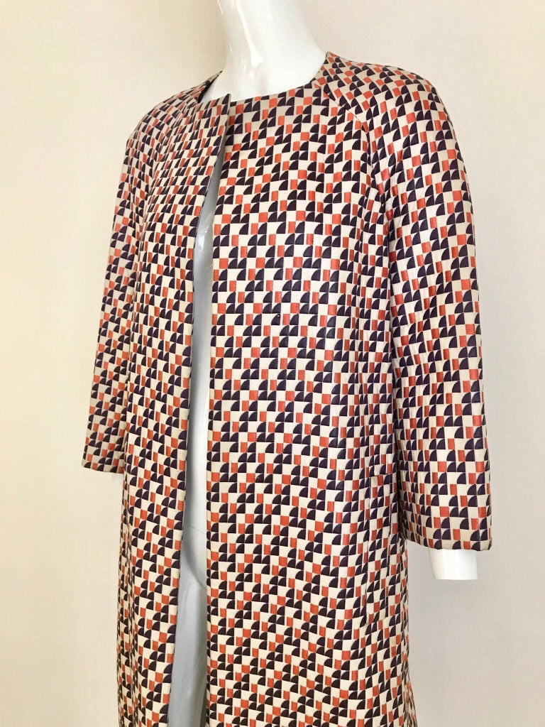 Beautiful multi color woven print coat in orange and purple blue. Size: MEDIUM- LARGE BUST: 42 Inches Coat length: 42 inches/ Sleeve length: 18 inches. Coat is lined with blue silk.