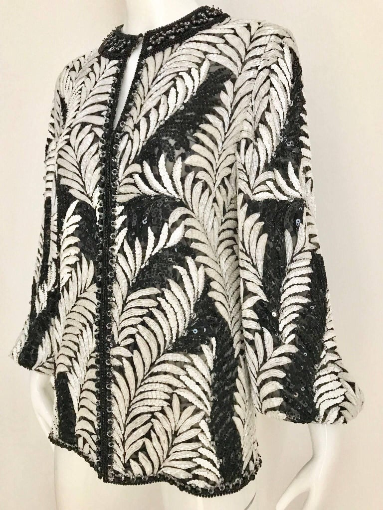 Late 80s James GALANOS black and white leaf motif beaded bomber jacket. Jacket is very heavy (4 lb) beautiful bugle beads. Jacket is lined in silk.  Size Medium (6) Bust: 36.5  inches ( when jacket is zipped) Sleeve length: 23 inches/  jacket