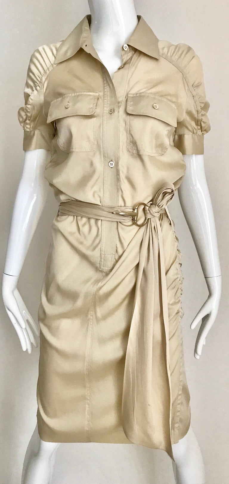 Gucci by Tom Ford tan silk shirt dress with belt. Size: Small Marked size 40 but it fit smaller. ( small smudge near pocket) see image attached Bust: 32 inches/ Hip: 34 inches. **** This Garment has been professionally Dry Cleaned and Ready to