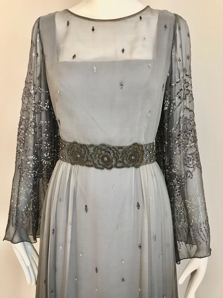 Beautiful 1970s Richilene Grey Silk chiffon Dress with silver sparkles appliques all over bodice and skirt. Romantic and perfect for wedding event or summer evening party. Dress come with grey silk ribbon sash with embroidered beads. Size: