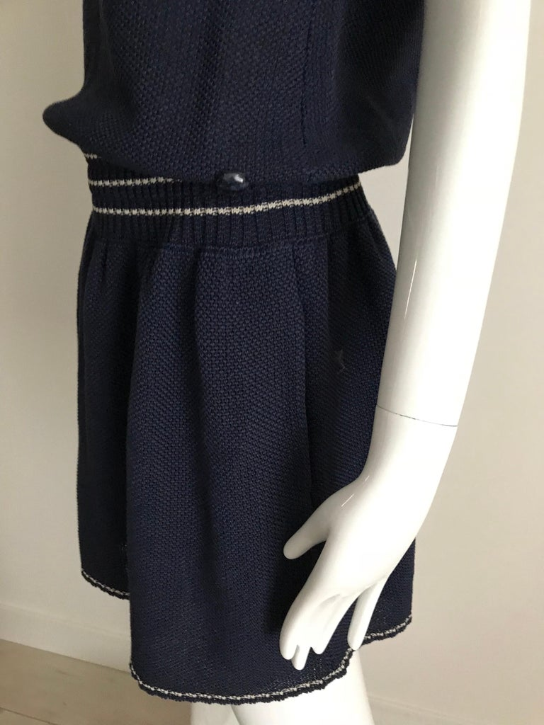 Chanel sleeveless Navy blue knit dress with blue and white piping tassel on the sleeve and collar. Fun casual attire.  Marked size: 42F/ Medium Bust: 36-38 inches