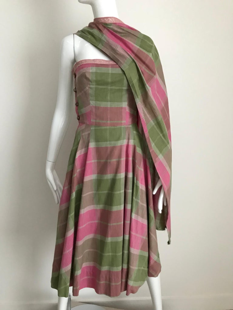 1950s Tina Lesser pink and green plaid cotton strapless dress with shawl attached. Bust: 36 inches/ Waist: 27 inches. Belt sold separately **** This Garment has been professionally Dry Cleaned and Ready to wear.