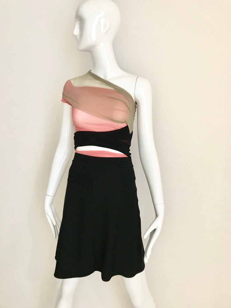 Vintage ALAIA black wool knit flare skirt. Waist: 24 inches stretch up to 28inches Hip: 34 inches/ Skirt length: 19 inches
