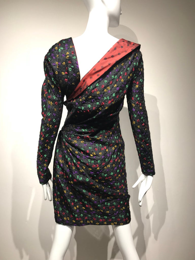 Vintage Givenchy Couture black silk matelasse cocktail dress with asymmetrical neckline and multi color irregular shaped dots in yellow, red, purple and green.  On the front of the dress, there is a diagonal ruching across the bodice to the hip,