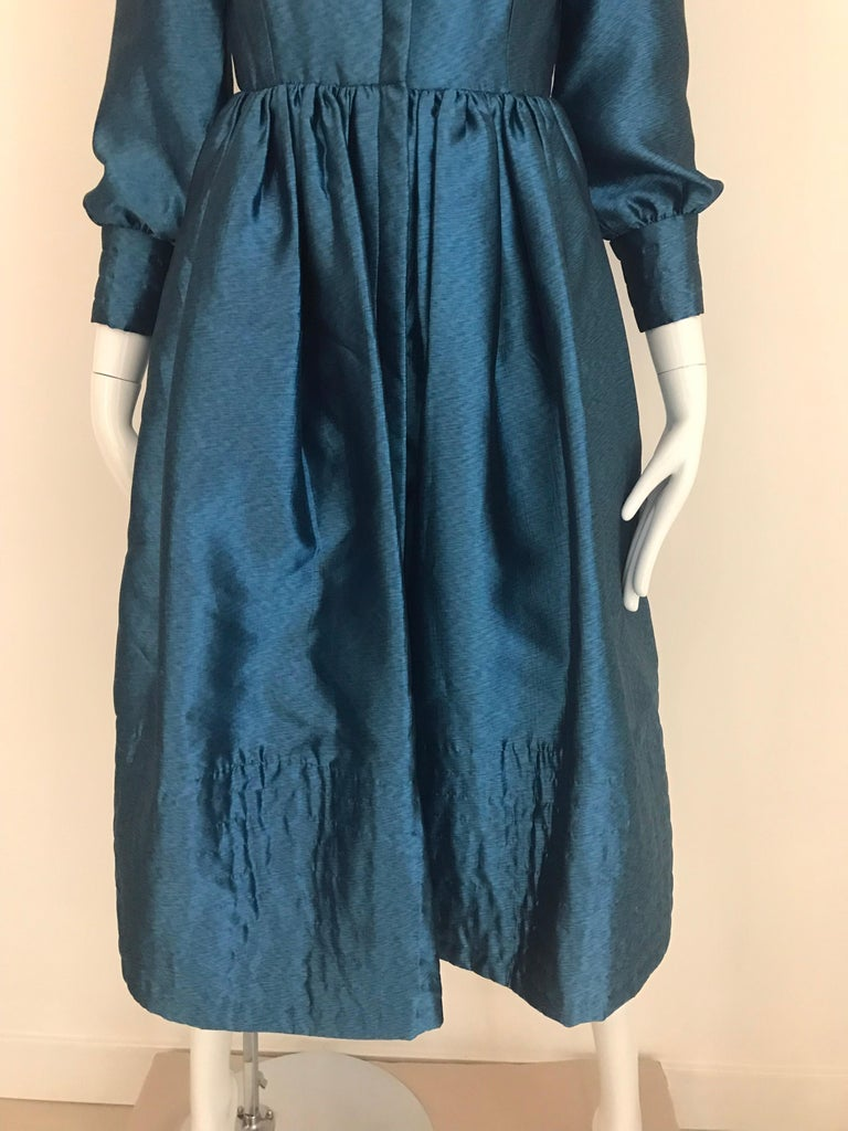 Classic Geoffrey Beene Blue teal silk dress with front zipper. Size: small - 2/4 Bust: 34""