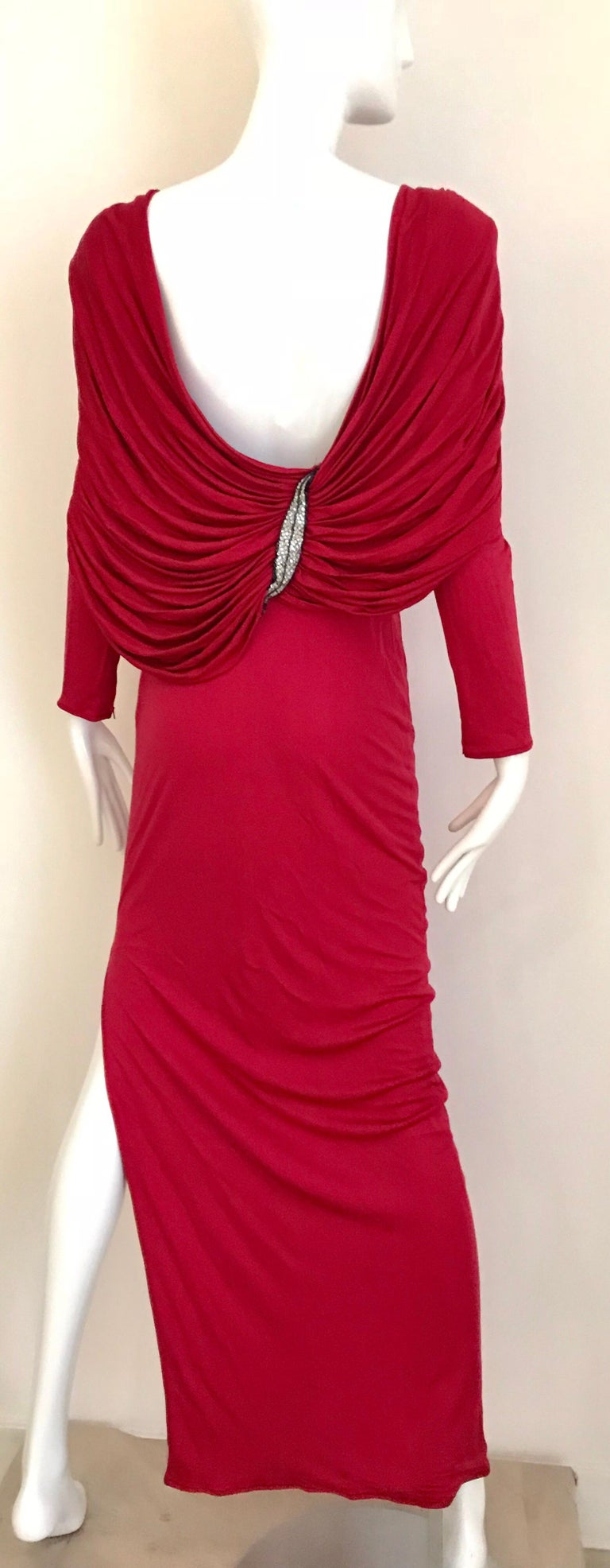 Beautiful vintage VALENTINO boutique silk jersey red ( more berry tone) long sleeve dress with open back ( drape). Dress has beaded appliqué on both shoulder. Perfect for holiday party. Fit best for US size 0/2/ max 4.  Although the dress marked