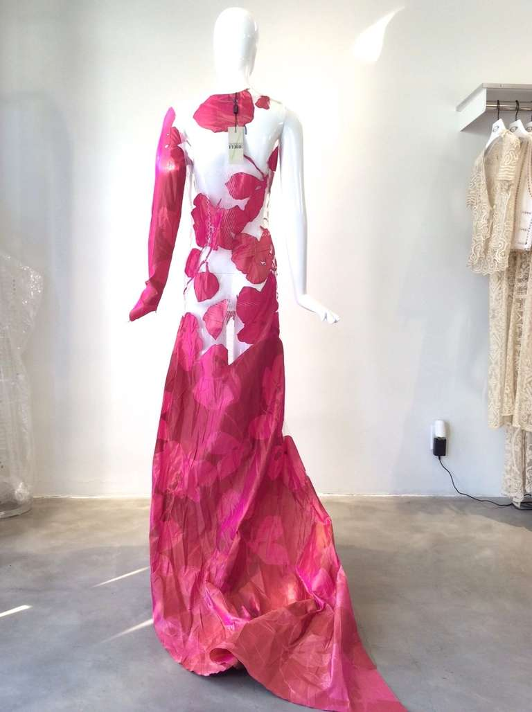Rare Dead-stock Vintage Gianfranco Ferre Spring 1999 runway gown Fushcia silk floral applique gown. This gown is made of silk applique on sheer net fabric. Long sleeve and zip on the side. Museum Quality and perfect for vintage collectors.  Fit US 4