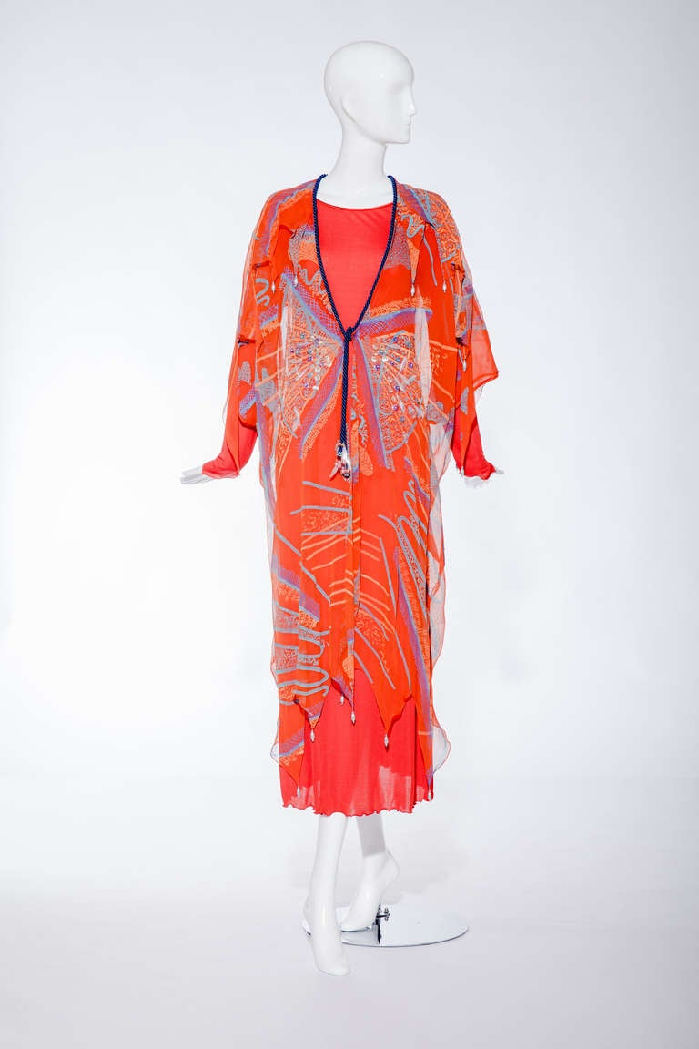 Vintage Zandra Rhodes From the spring/summer 1976 Orange Silk chiffon caftan with blue silk cord and some sequins and beads.  caftan comes with matte jersey slip. The slip fit size 2/4 but the kaftan jacket fit size 8/10 Fit size : 2/4/6 US size.