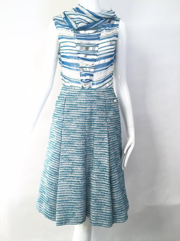 """CHANEL blue boucle blazer , cowl neck silk blouse and A line skirt set.  Blazer : size 6 Blouse : size 6 Skirt waist : 27"""" In excellent condition."""
