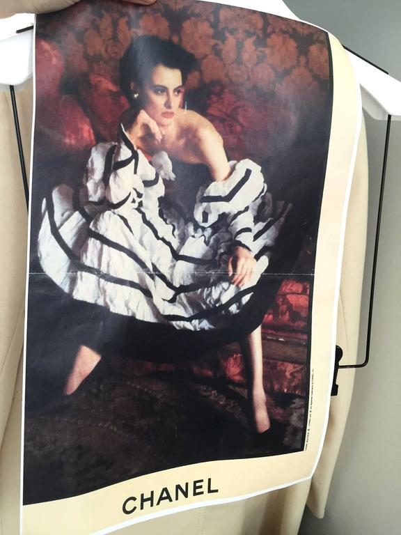 Rare 1990s Chanel Off-white crushed silk, black cotton velveteen, and black silk satin ribbon. corset boning. mutton sleeve with elastic. camellia flowers Bust: 34
