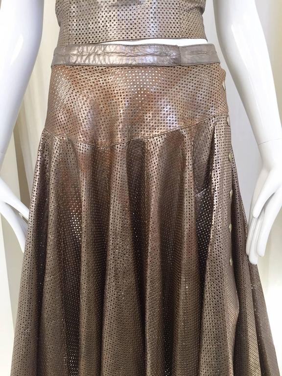 1980s Ted Lapidus bronze metallic perforated spaghetti strap top and skirt.  Top measurement: Bust: 36
