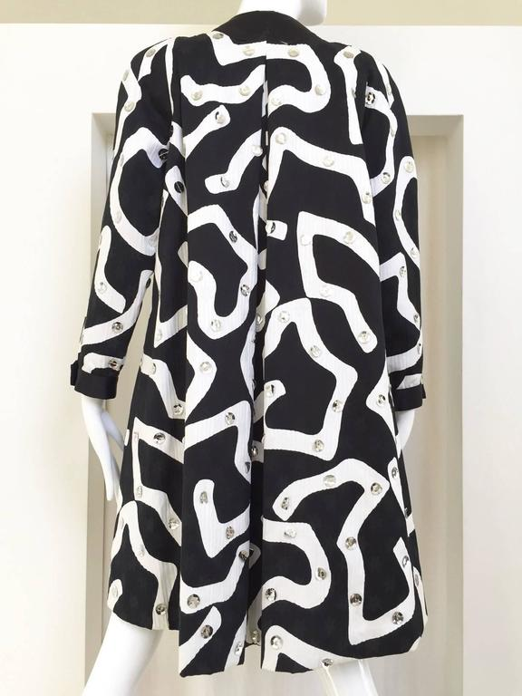80s Geoffrey Beene black and white abstract print cotton coat with large silver sequin. Tent style with inverted pleat at the back.  Size : 8/10 / Medium   ***All Clothing has been professionally Dry Cleaned and ready to wear.