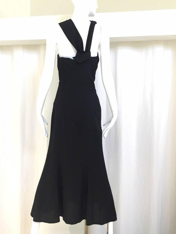 Sexy  Vintage  Thierry Mugler black dress with  asymmetrical neckline.  Perfect cocktail dress for summer.  Slit on the side. Tag size: 38 Bust: 33