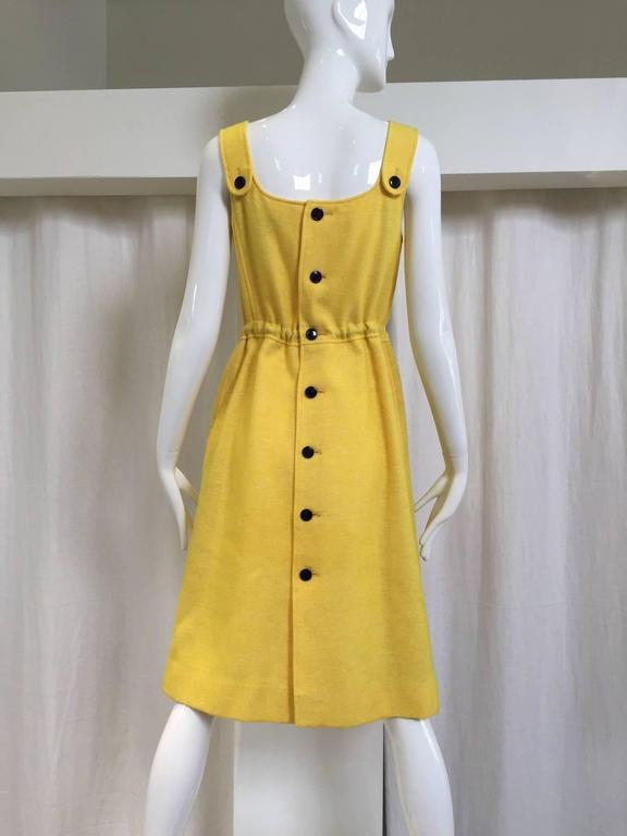 "1960s Courreges yellow wool dress with adjustable drawstring waist and 2 pockets. Button all the way at the back.  Dress is lined. Small. Fit size 4 Bust: 32""/ Waist: 26"" / Hip: 38"" /  Length: 40"""