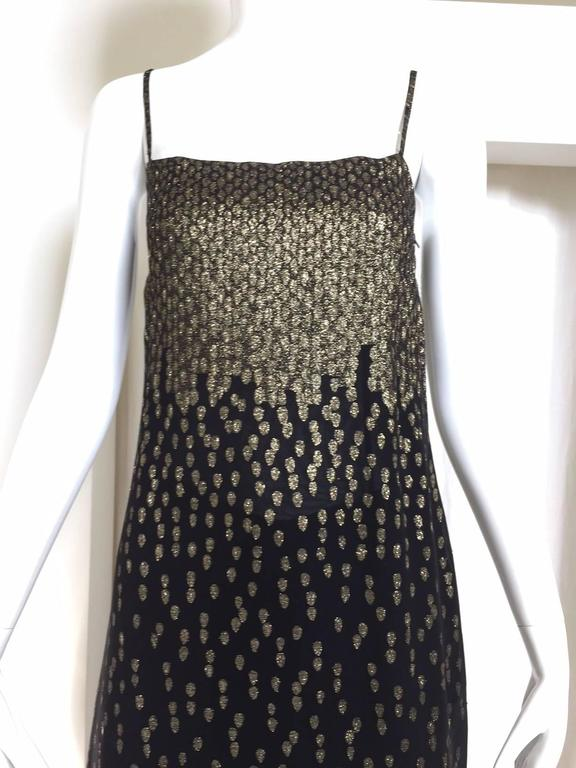 "70s Christian Dior Metallic gold and black silk tunic top and pant ensemble. spaghetti strap and zipper on the side.  Fit US size 2 Bust: 32"" / Waist: 29"" / Hip: 32"" / Tunic top length: 45"" Pant waist: 27"" (elastic) / Hip:"