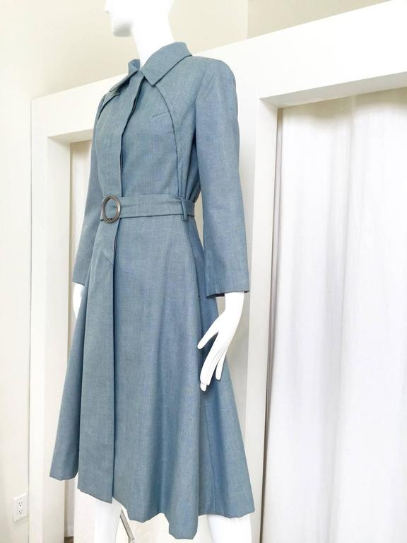1970s Donald Brooks light blue cotton trench coat with belt.