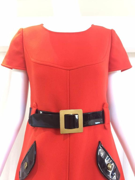 "Vintage 1960s courreges paris orange wool mod dress with patent leather belt. patent leather pockets. Size: 6 Medium Bust: 36""/ Waist: 30""/ hip: 36"" / Length: 37"""