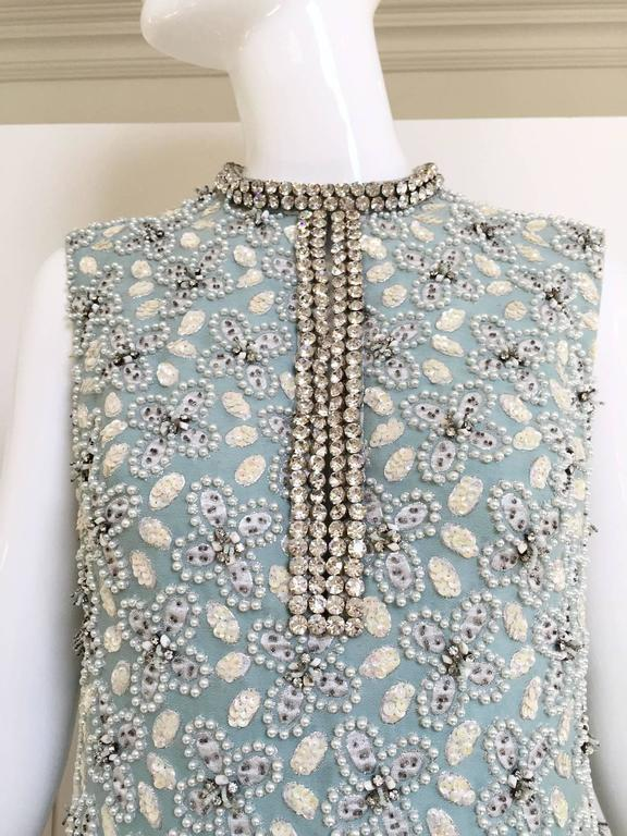 """Incredible vintage 1960s light blue heavy cotton beaded gown with white small clustered pearl  and rhinestones collar. Chic and timeless Cocktail gown. Bust: 36""""/ Waist: 33"""" /Hips: 38""""/ Length: 54"""" Size: Medium"""