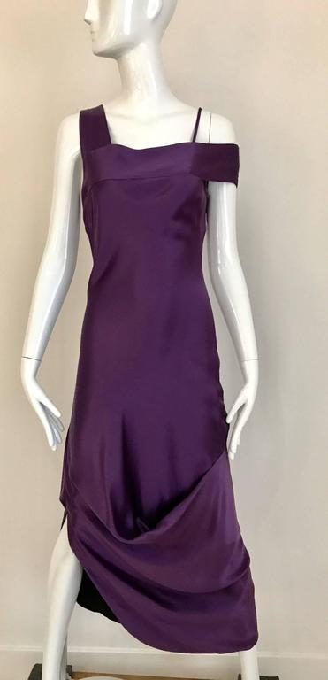 Vintage Alexander Mcqueen violet silk charmeuse Grecian gown with incredible drape and asymmetrical shoulder.  Fit Size: 4/6 Small- Medium   Bust: 34 inch  / Waist: 30 inch  /Hip: 38 inch/  Dress Length: 55 inch  **** This Garment has been