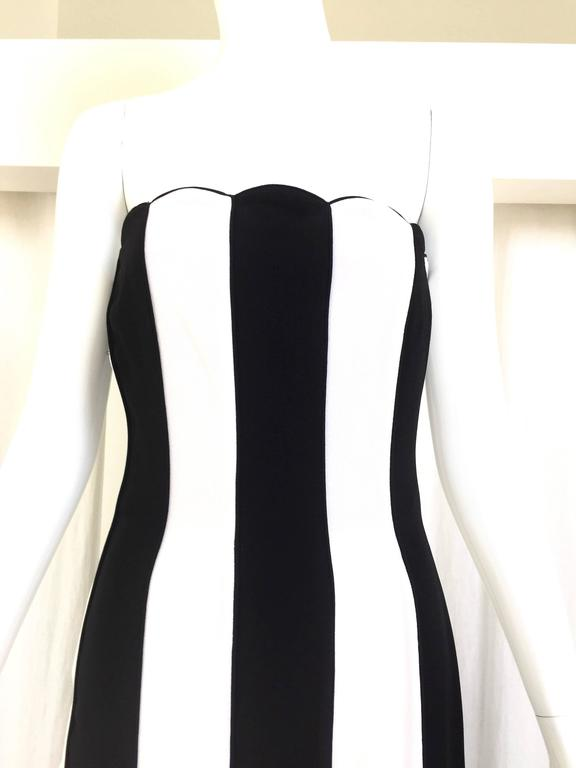 "Vintage 1990s VALENTINO black and white strapless gown. See runway picture attached. Size 2/Small Bust: 30"" Waist: 28""/ hip: 36""/ Length: 54"