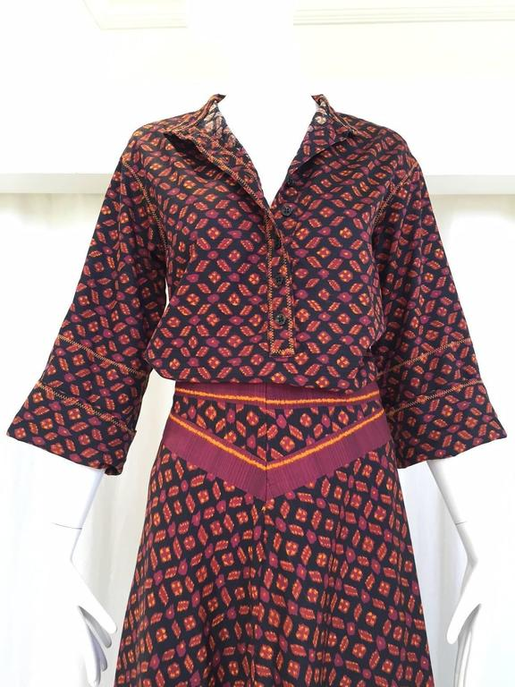 "Vintage 1970s Anne Klein chic cotton burgundy and black ikat print blouse and maxi skirt ensemble. Blouse has 3/4 sleeve.   Fit Size Small - Medium Blouse size: 6, Top is Size 6 Bust: 40""  20"", Back collar to hem 25.5"" Sleeve 11"""