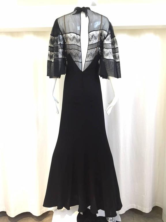 For Design purpose or study. The fabric is fatigued in places, with various small tears and small holes on lace area. if you replace the bodice part with new lace, this dress is wearable. The black crepe portion is still in great condition. Size: 6