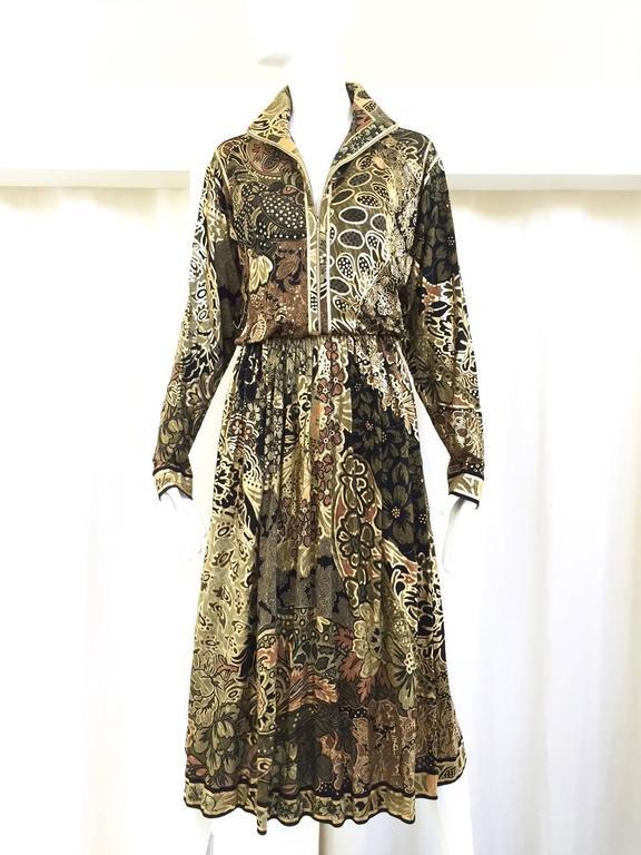 80s LEONARD gold and black jersey dress. Front zipper, elastic waist with sash. Bust: 38