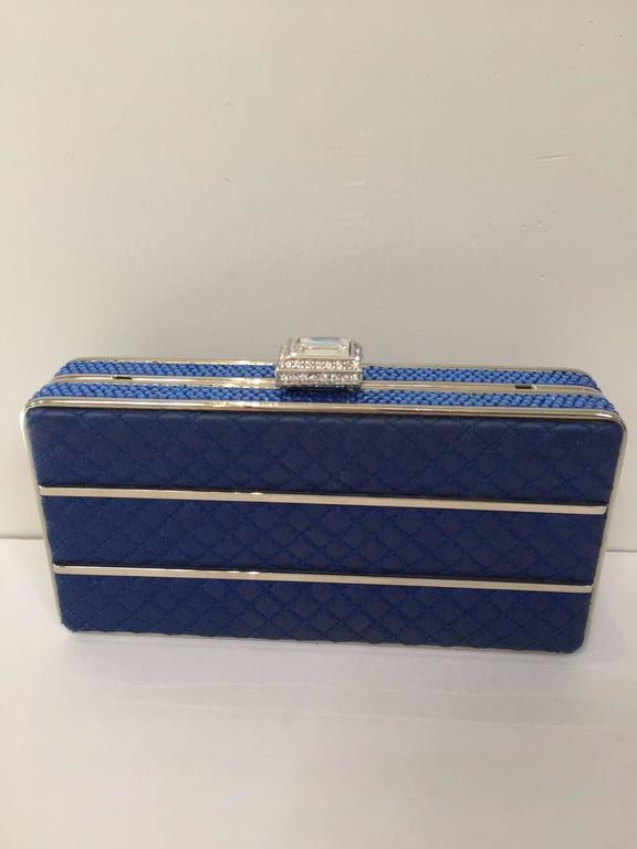 Judith Leiber evening blue satin clutch with rhinestones and strap.