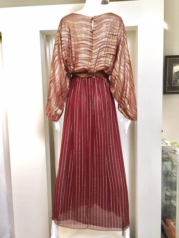 1970s Bill Blass burgundy metallic silk maxi dress with sash.  Fit Size : 4 / Small Bust:         / Waist: 26.5