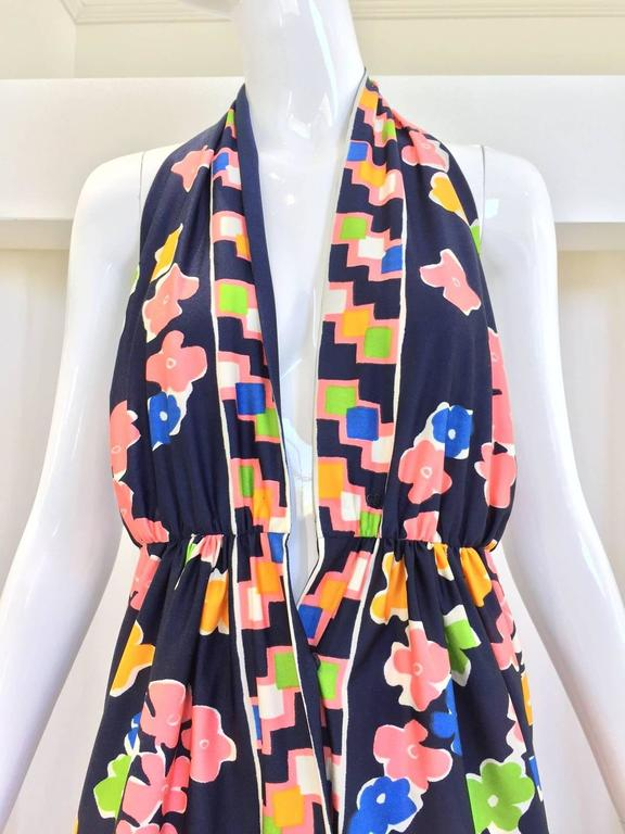 """What a fun summer jersey halter dress from vintage Oscar De La Renta. Navy blue color with chartruese , peach pink, yellow floral print halter dress. perfect for summer vacation at st.barth! wrinkle resistant. Bust: 36"""" / Waist: 26"""" Hip: 40"""" Length:"""