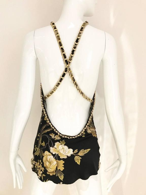 Beautiful silk charmeuse print roberto Cavalli Halter top in gold chain strap with exposed bare back.  Fit size 4/ SMALL Bust: 34 inch  ***All Clothing has been professionally Dry Cleaned and ready to wear.