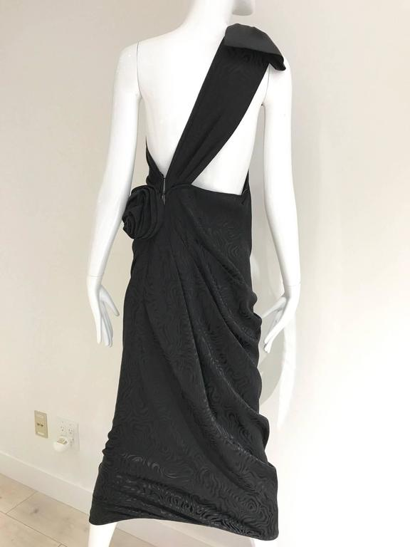 """Chic vintage Ungaro black silk jacquard one shoulder cocktail dress with bow and exposed back.  Black tie party or cocktail dress Fit size 4/  small to Medium.  Bust: 34""""/ Waist: 27""""/ Hip: 35""""   *** This Garment has been"""